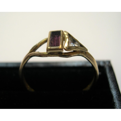 16 - Unmarked yellow metal ring with clear stone and garnet  Approx 1.4 grams gross           size R...