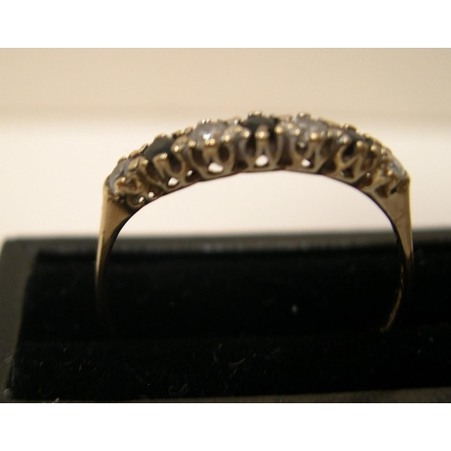 20 - 9ct yellow gold, half eternity ring with sapphire & clear stone ring  Approx 1.1 grams gross,       ...