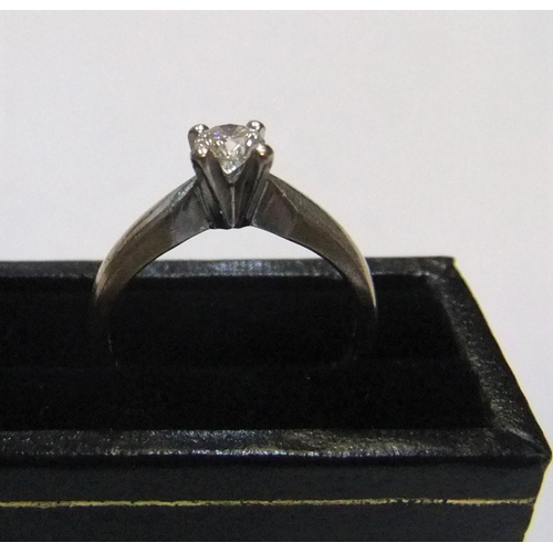 83 - 18ct white gold diamond solitaire ring (approx 0.2ct)  Approx 3.1 grams gross,         size I...