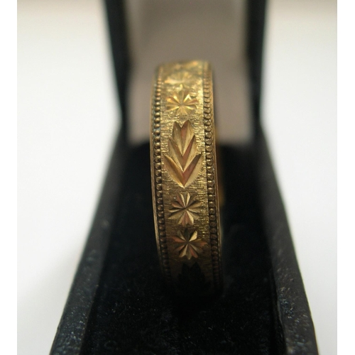52 - 9ct yellow gold band ring, extensively engraved  Approx 1.9 grams,          size W...