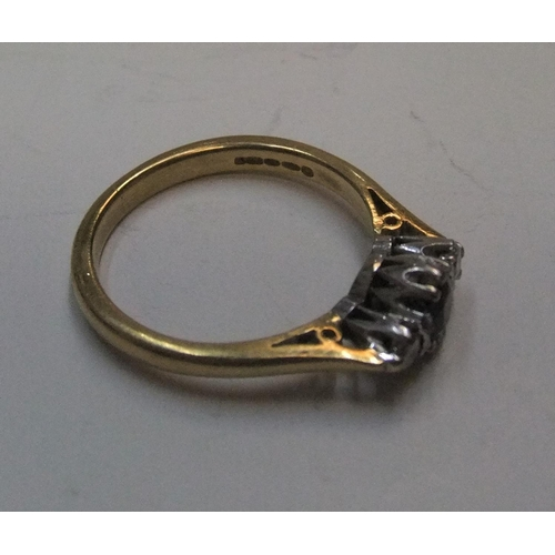 5 - 18ct yellow gold ring set with a central sapphire with a diamond on either side  Approx 4.5 grams gr...