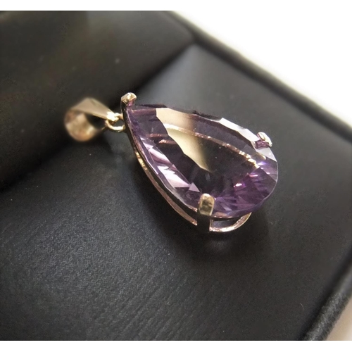 44 - Large solitaire pear cut amethyst set in 9ct yellow imported gold  Aprrox 1.3 grams gross,...