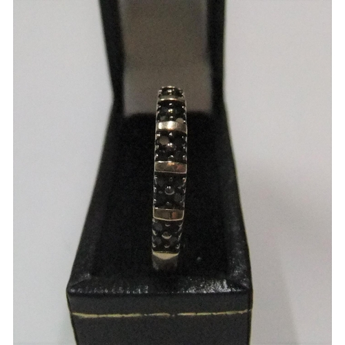 45 - unmarked/untested yellow gold ring with 20 small round cut black diamonds   Approx 1.7 grams gross, ...