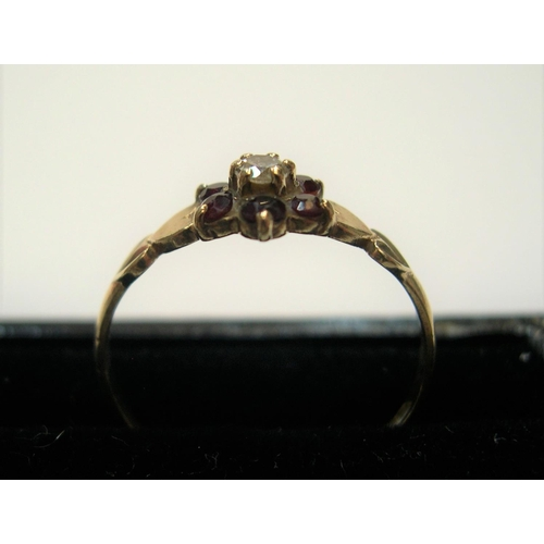 8 - 9ct yellow gold ruby flower ring   Approx 1.2 grams gross              size N...