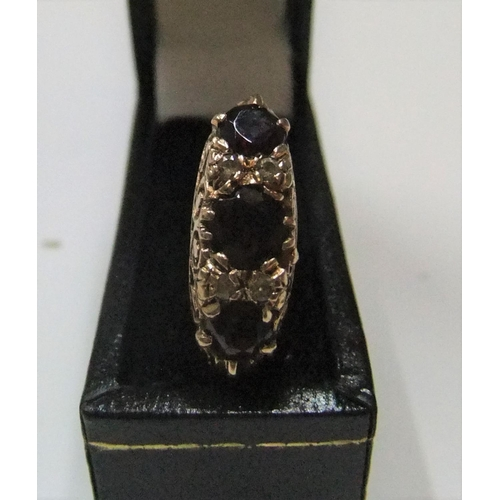 46 - 9ct yellow gold 3 stone garnet ring  Approx 3.9 grams gross,            size K/L...