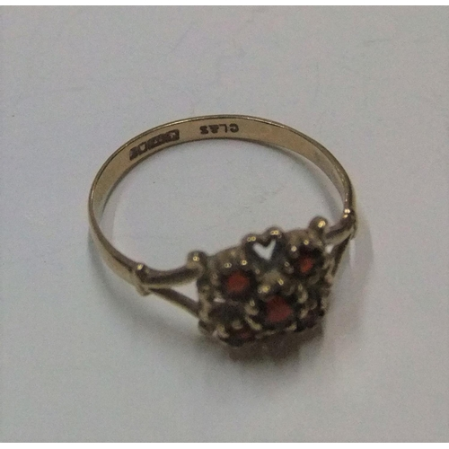 1 - 9ct yellow gold, 5 garnet ring  Approx 1.5 grams gross,           size N/O...