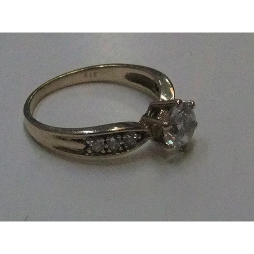 21 - 9ct yellow gold CZ solitaire ring  Approx 2.4 grams gross,         size K...