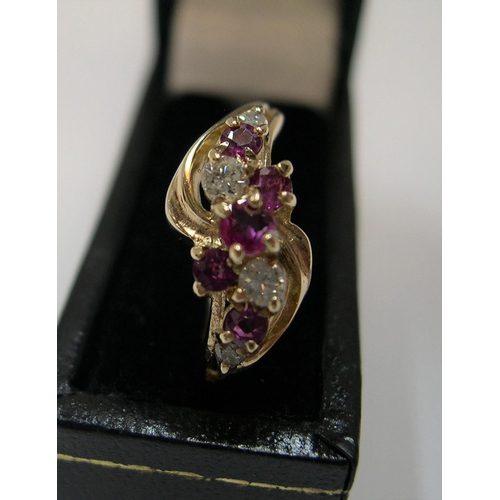 22 - 9ct yellow gold with a modernist ruby & diamond setting  Approx 1.9 grams gross,            size M...