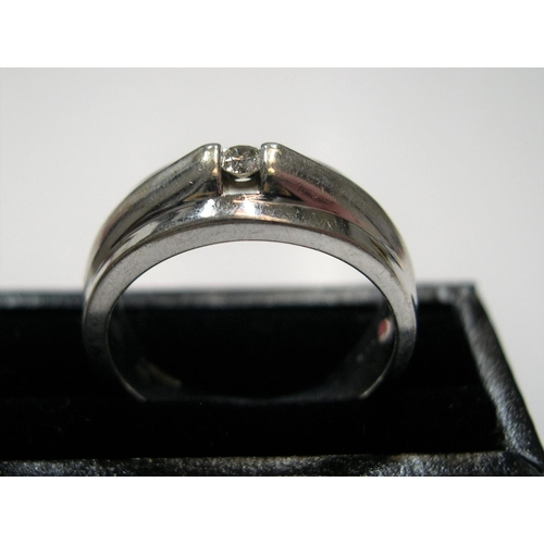 24 - Modernist 9ct white gold ring with small solitaire diamond  Approx 6.5 grams gross                si...