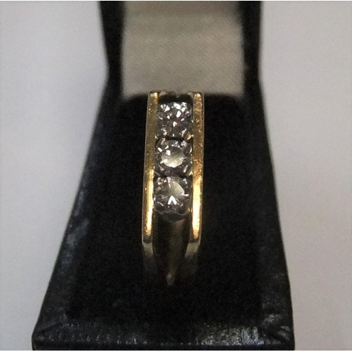 50 - 18ct yellow gold 3 stone diamond ring (approx 0.15ct)  Approx 3.2 grams gross...