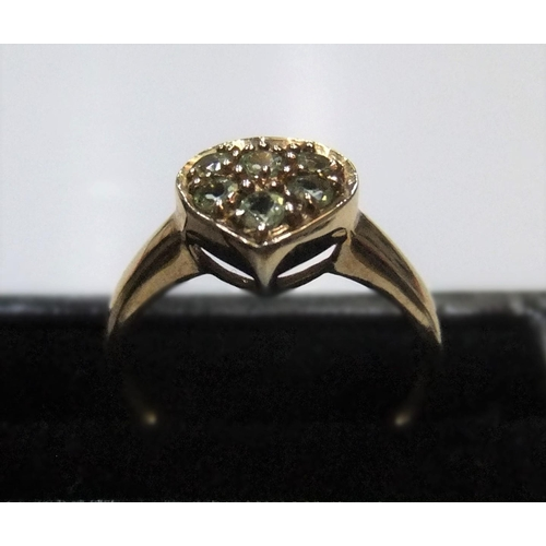 76 - 9ct yellow gold, heart shapped ring filled with green stones (probably peridots)   Approx 2.2 grams ...