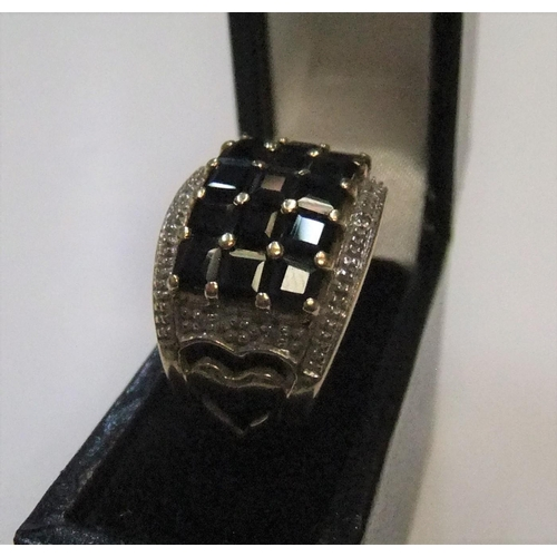 77 - Gents 9ct yellow gold, sapphire 3 row ring   Approx 4.9 grams gross,          size L...