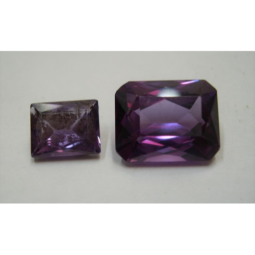 33 - 2 Sapphires, approx 11cts total  the 2 stones measure approx 13 x 10mm & 9 x 7 mm...
