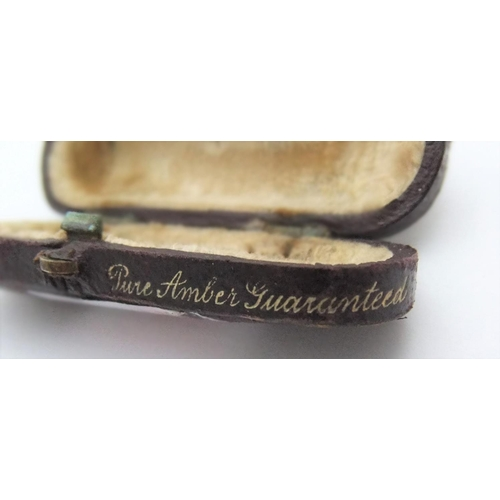 94 - Late Victorian cased, 9ct gold tipped, amber cheroot holder,  5cm in length...