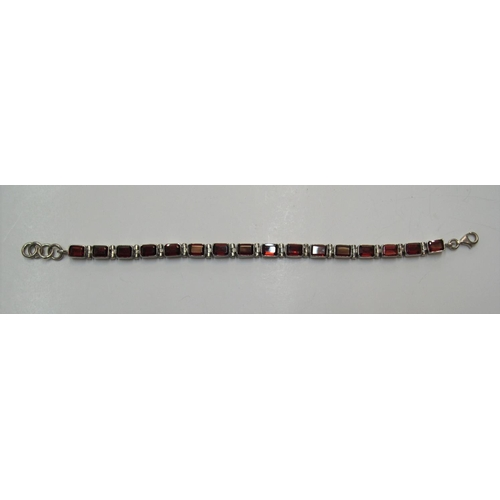 115 - Silver bracelet with red stone panels, 20cms long...