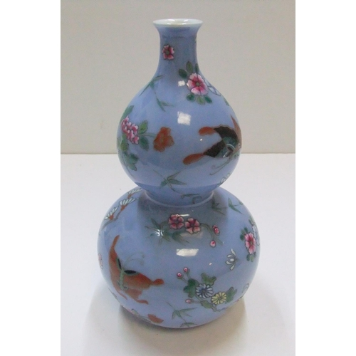 175 - Chinese double gourd blue vase with impressed marks to base  22 cm high...