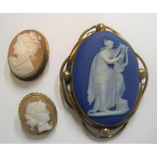 54 - 3 old cameo brooches, the largest stamped Wedgewood verso,  Largest measures 5 x 4 cm...
