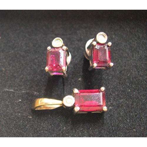 33 - Art nouveau, matching set of earrings and pendant, all set with a baguette cut ruby below a circular...