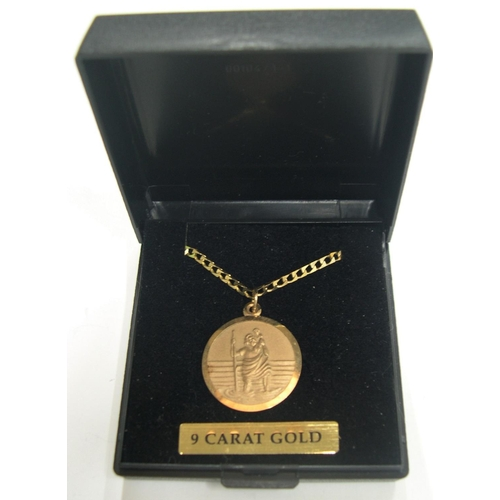 39 - 9ct yellow gold St Christopher pendant on 9ct gold chain, boxed,  The chain is 23 cm long,          ...