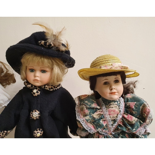 60 - 4 porcelain decorative large dolls all on metal stands, 1 with label for Alberon Dolls of London,  A...