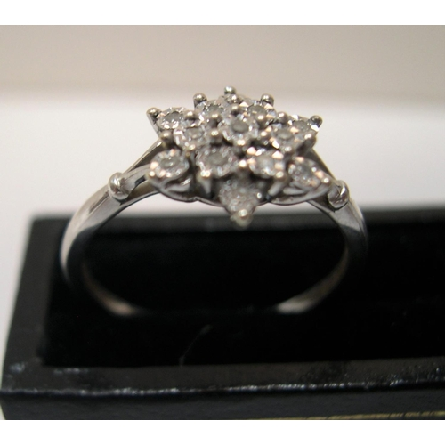 41 - 9ct white gold, diamond cluster ring  Approx 2.1 grams gross,                   size O...