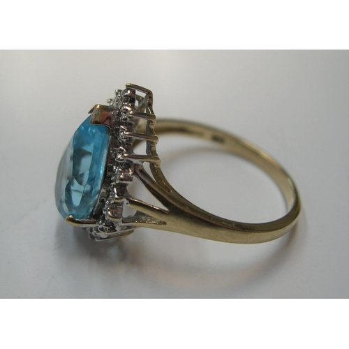 37 - stunning 9ct yellow gold pear cut blue topaz surrounded by diamonds  Approx 3.4 grams gross         ...