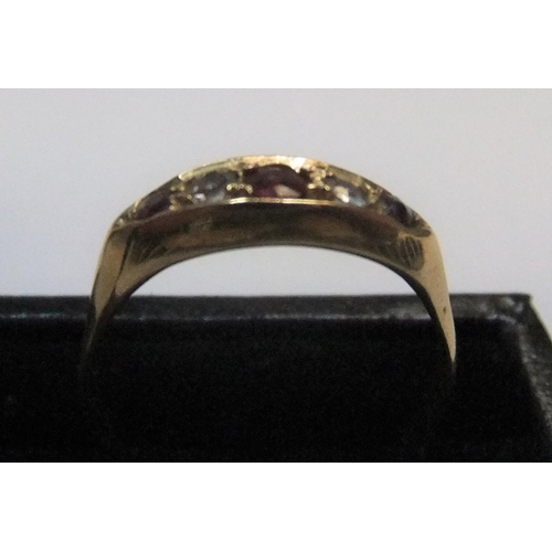 7 - 18ct yellow gold boat shaped ring with rubies & diamonds  Approx 2.7 grams gross,        size O/P...
