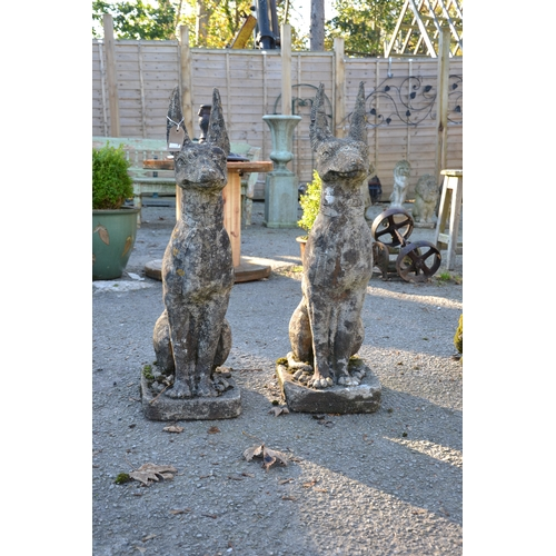 2 - Pair of Egyptian guarding dogs in the form of Anubis, in concrete  (ears A/F). Height 87cm...