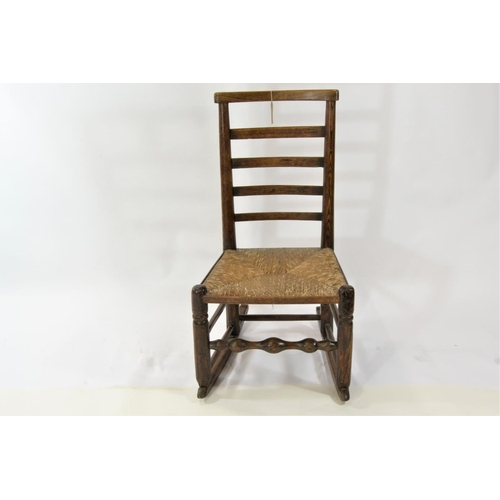 27 - Converted rocking chair with rush seat and ladder back...