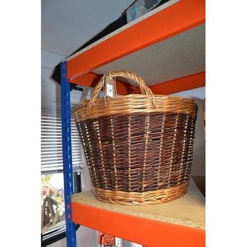 16 - Medium size wicker log basket...