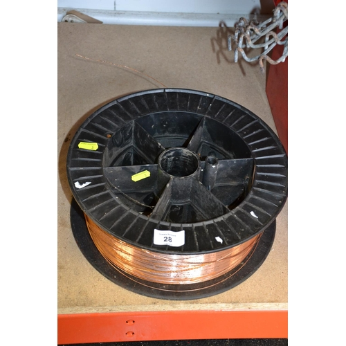28 - Large roll of copper welding wire on reel...