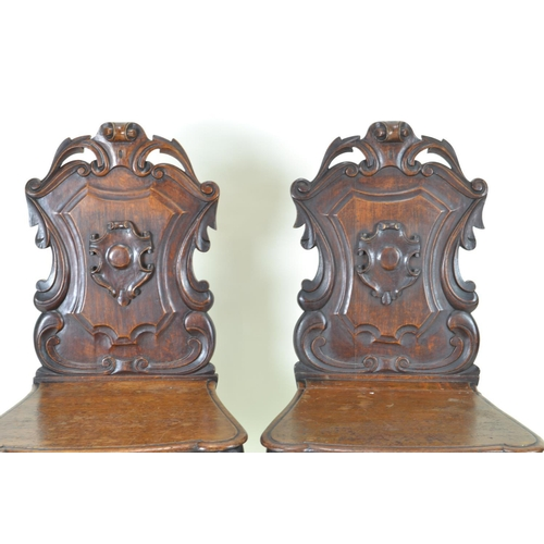 84 - Pair of armorial oak chairs...