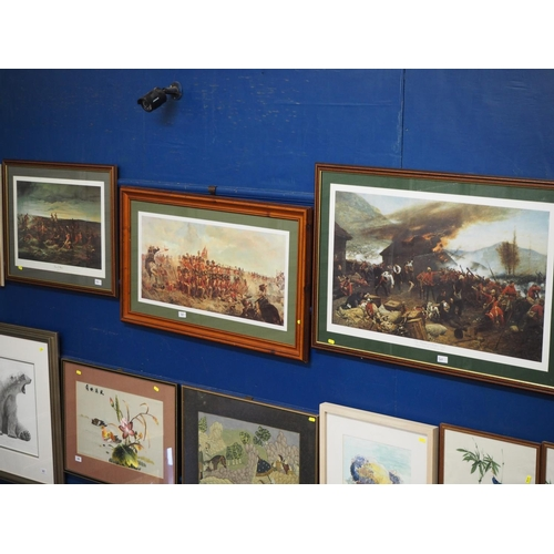 501 - Three framed prints of battles, two titled 'The Defence of Rorke's Drift'  &  'Down of Waterloo'...
