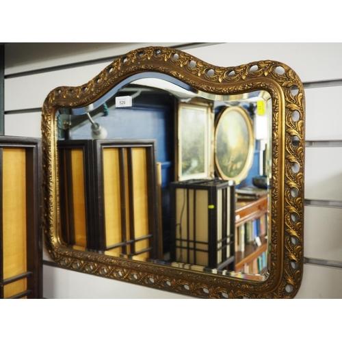 526 - Ornate gilt framed bevelled mirror. Width 64 CM....