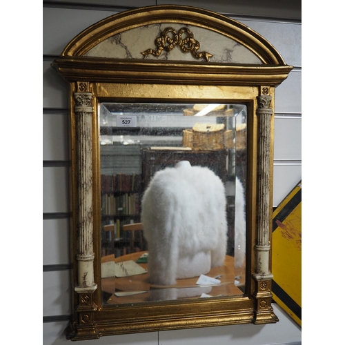 527 - Pillared gilt framed bevelled mirror with arch top. Height 52 CM....