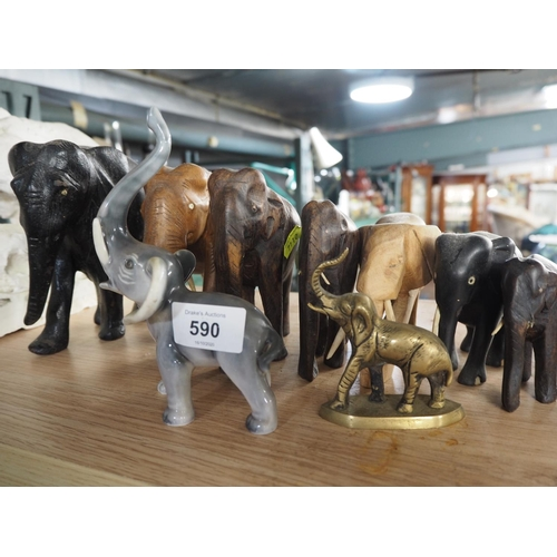 590 - Collection of ten elephant figures including wood, ceramic & brass...