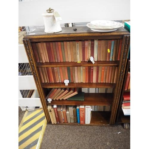 600 - Carved oak four shelf bookcase, 92cm high, 68cm wide, 19cm deep...