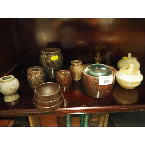 608 - Serpentine and other Hardstone items on shelf including onyx & a Bakelite ashtray...