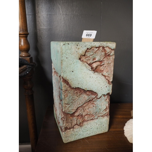 669 - Moulded square form candle stick. 22.5cm high...