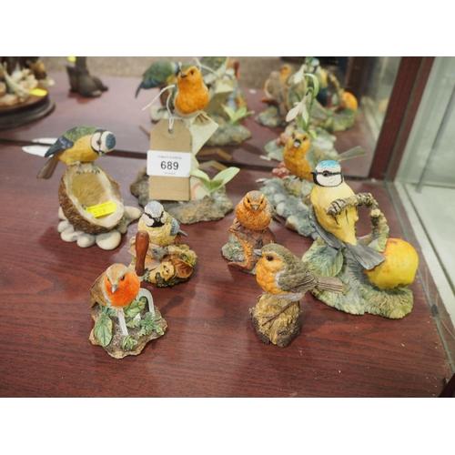 689 - 8 Border Fine Arts song bird figures...