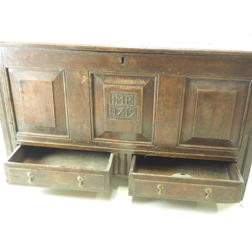 20 - Large coffer/mule chest with carved panel on front saying MP J719. 2 drawers 2 base. Width 126 Cm. D...