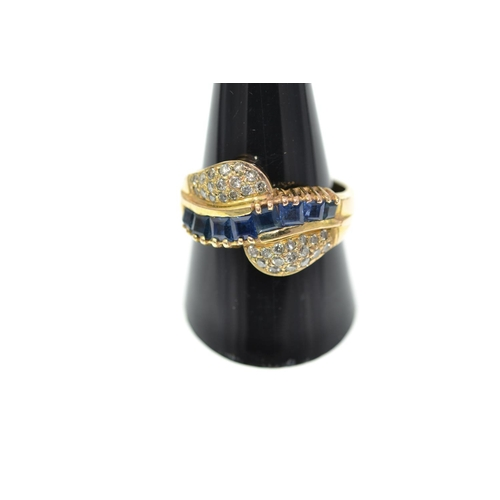 309 - Sapphire & diamond modern twist design ring, set with 8 square cut sapphires and 2 groups of sixteen...