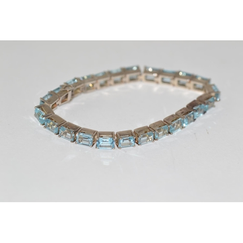 319 - Silver & light blue coloured stone set bracelet, 180mm length...