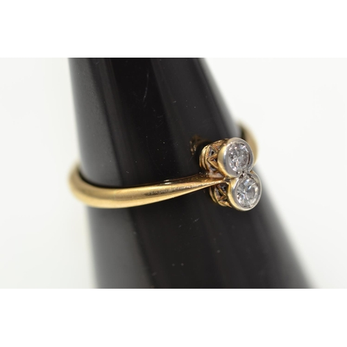 335 - 18ct gold ring mounted with a pair of bezel set diamonds.  Each .1carat. Gross weight 2.4g. Size P...