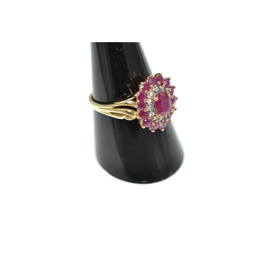 344 - 9ct gold,  ruby & diamond cluster ring, size Q/R set with 15 rubys including a .65carat central ston...
