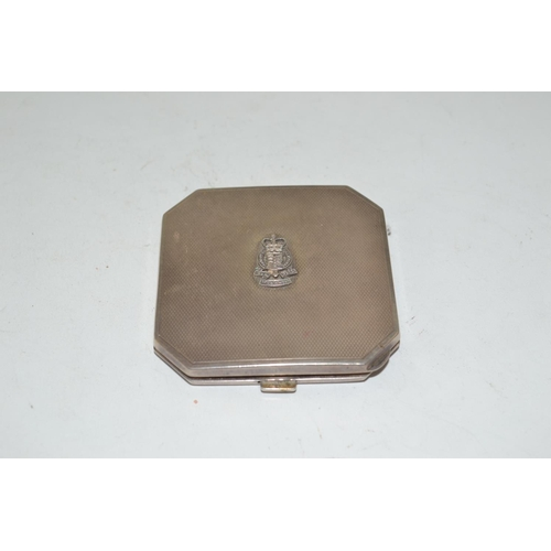 435 - Silver powder compact, maker T&S, Birmingham 1958, engine turned pattern with applied Royal Corps ba...