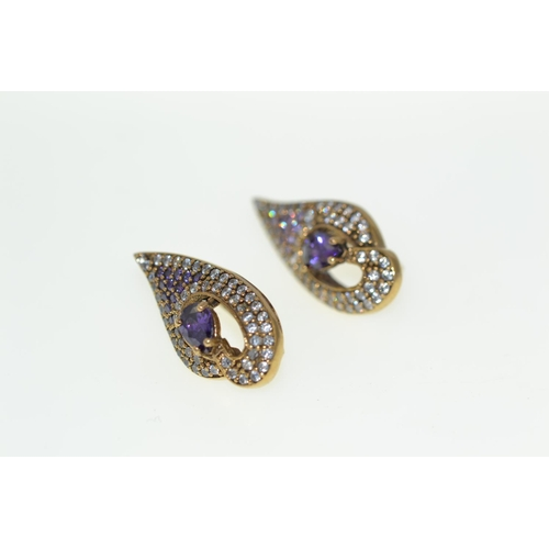 384 - Pair of silver gilt earrings & a pendant...