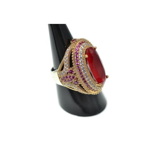 386 - Silver gilt & stone set dress ring, size P1/2...