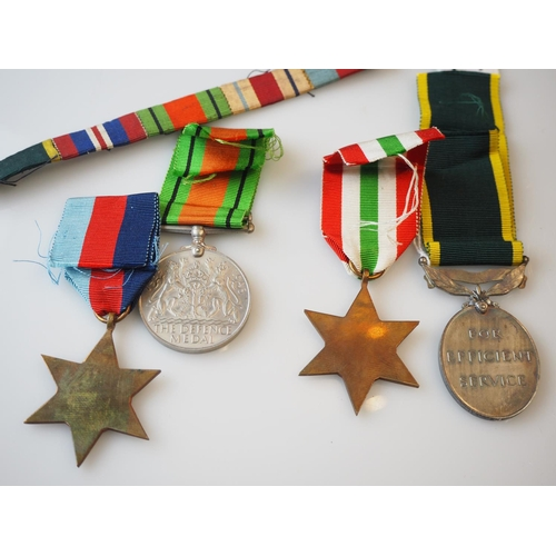 239 - WWII group of medals including Territorial medal inscribed '2057852 GNR V. Valpy R.A' & ribbons, wit...