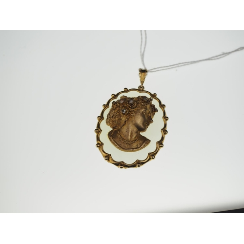 285 - 9ct gold & diamond cameo mounted on cabachon chalcedony pendant with 9ct gold surround. 5cm x 3.6cm...